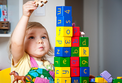 preschool child with building blocks