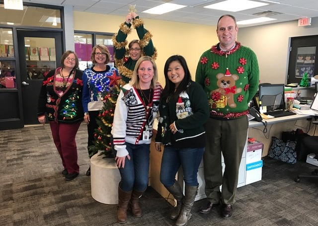 MacNaughton office staff wearing ugly Christmas sweaters